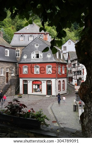 MONSCHAU, GERMANY, JULY 25: Street view in the historical town center of Monschau a small resort town and a popular tourist attraction in the Eifel region of Germany. Photo taken on July 25, 2015 - stock photo