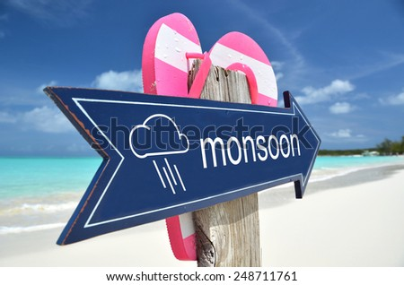 MONSOON AHEAD beach sign - stock photo