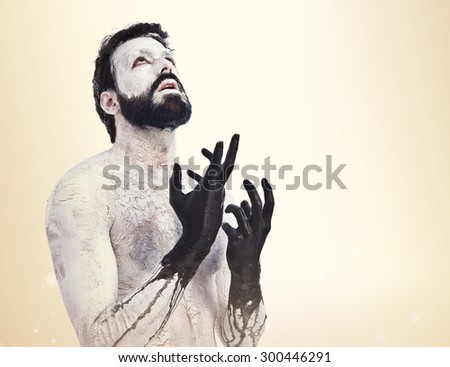 Monster looking up over ocher background - stock photo