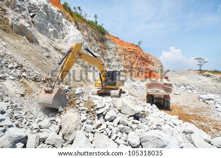 Monster machines working on site - stock photo