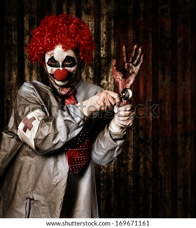 Monster medical clown checking the pulse on a rotten severed human hand with stethoscope. Black market limbs - stock photo