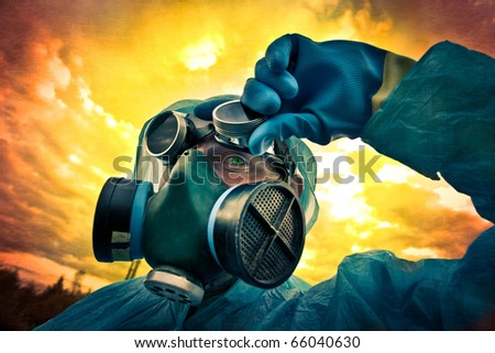 monster under the mask under toxic skies - stock photo