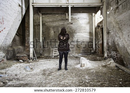 Monstrous woman in abandoned house, violence - stock photo