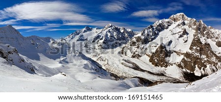 Mont Blanc de Courmayeur, Aiguille de Tr���©-la-T���ªte, Aiguille des Glaciers, and Miage Glacier seen from Cresta Youla. Part of the Graian Alps range. - stock photo
