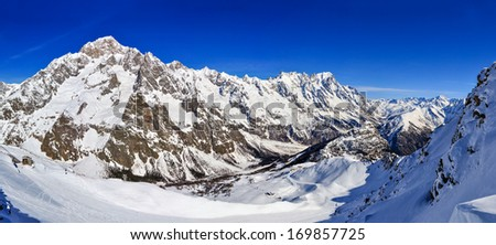 Mont Blanc de Courmayeur, Val Veny, and the ski slopes of the Courmayeur ski domain. - stock photo