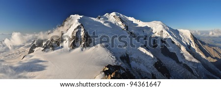 """Mont Blanc (French) or Monte Bianco (Italian), meaning """"White Mountain"""", is the highest mountain in the Alps, Western Europe and the European Union. - stock photo"""
