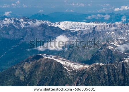 Mont Blanc is the highest mountain in the Alps and the highest in Europe. Panorama of Aiguille Verte and snowy ridge with mountaineers. Beautiful panorama of European Alps in sunny day.