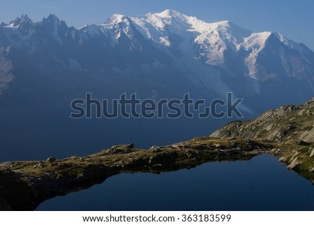Mont Blanc reflected in Cheserys Lake, Mont Blanc Massif, Alps, France - stock photo