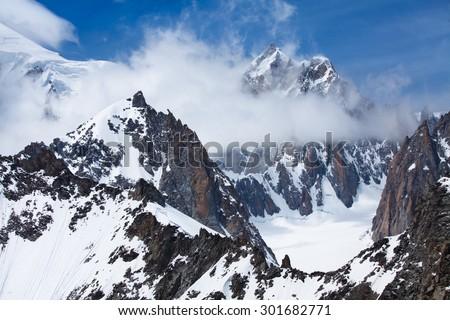 Mont Blanc snow peak, Brenva glacier, Mont Blanc du Tacul from Punta Helbronner station in Italian side - stock photo