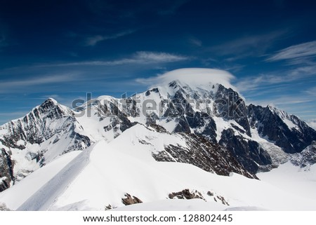Mont Blanc summit at cumulus cloud - stock photo