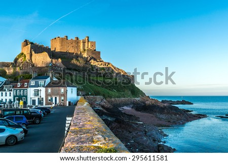 Mont Orgueil Castle (Gorey Castle, built 1204 - 1450) in the small town of Gorey at sunset. Jersey, UK. - stock photo