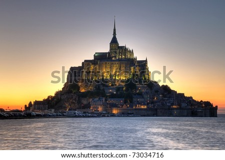 Mont Saint Michel (4) Abbey in Normandy, France at sunset - stock photo