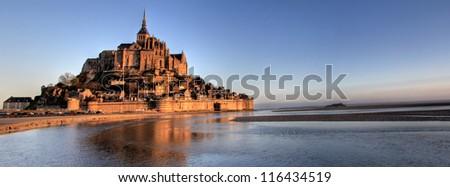 Mont Saint Michel bay taken at dawn. Normandy , France . Panorama - stock photo
