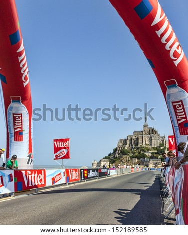 MONT SAINT MICHEL,FRANCE-JUL10: Image of the road to Mont St. Michel monastery during the stage 11 of the edition 100 of Le Tour de France on July 10, 2013