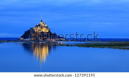 Mont Saint-Michel in evening - stock photo