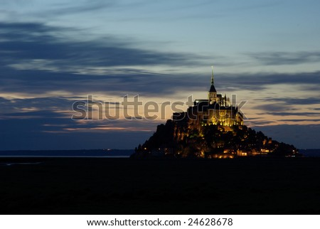 Mont Saint Michel in France illuminated at sunset.