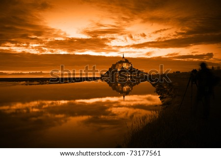 Mont Saint Michel reflected in the bay at sunset, France - stock photo