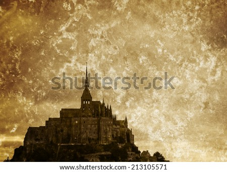 Mont Saint Michel UNESCO heritage site under cloudy sky. Normandy, France. Retro aged photo with scratches. - stock photo