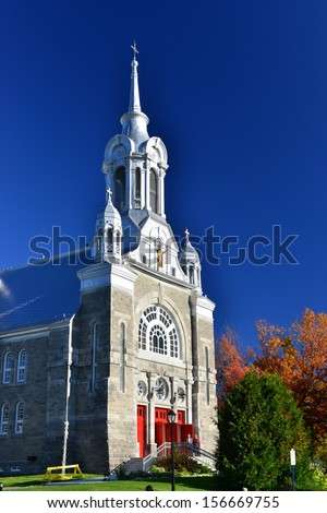 Mont Saint Sauveur Church in autumn, Quebec, Canada - stock photo