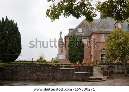 Mont Sainte-Odile abbey in a foggy day. Alsace, France. The Abbey is situated on the top of Sainte-Odile mountain in the Vosges mountain range.  - stock photo
