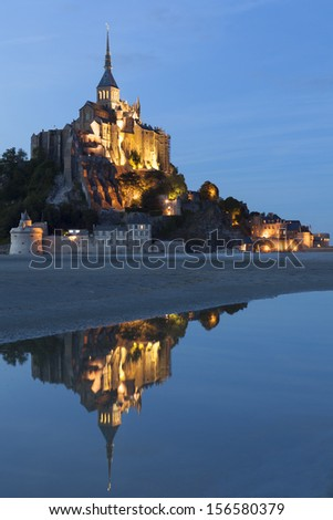 Mont St Michel in Normandy, France, Europe. Illuminated at night - stock photo