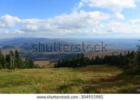 Mont Tremblant fall foliage, from top of Mont Tremblant, Quebec, Canada. - stock photo