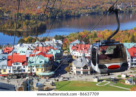 Mont Tremblant Lake and village in autumn, Quebec, Canada - stock photo