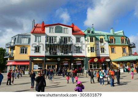 MONT-TREMBLANT, QC, CANADA - OCT 5: Colorful Houses on October 5th, 2014 in villiage of Mont-Tremblant, Quebec, Canada.  - stock photo