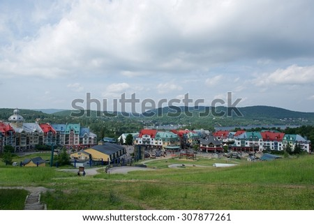Mont Tremblant, Quebec, Canada - July 16: panoramic view of a city in the Laurentian mountains of Quebec, Canada on July 16, 2015. Mont Tremblant is popular winter sport area in Quebec province