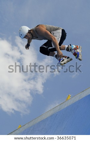 MONTANA, BULGARIA - SEPTEMBER 6 : Marco de Santi of Sao Paulo, Brazil participates in the Bulgarian Inline Halfpipe Championship September 6, 2009 in Montana, Bulgaria.