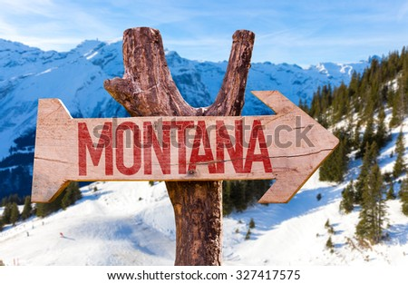 Montana wooden sign with winter background - stock photo