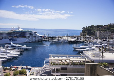 MONTE CARLO, MONACO - APRIL 28: View on Port Hercules with luxurious yachts and a cruise ship on April 28, 2015 in Monte Carlo, Monaco. - stock photo