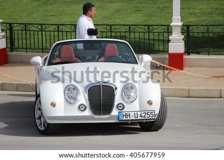 Monte-Carlo, Monaco - April 6, 2016: White Mitsuoka Roadster Parked in Front of the Monte-Carlo Casino in Monaco - stock photo