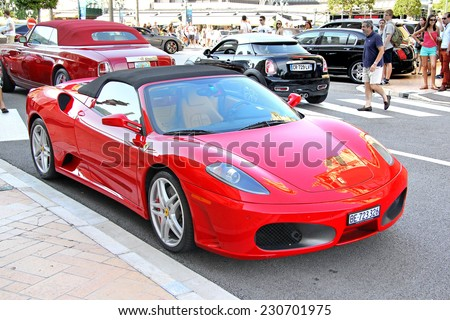 MONTE CARLO, MONACO - AUGUST 2, 2014: Red italian supercar Ferrari F430 Spider at the city street near the casino. - stock photo