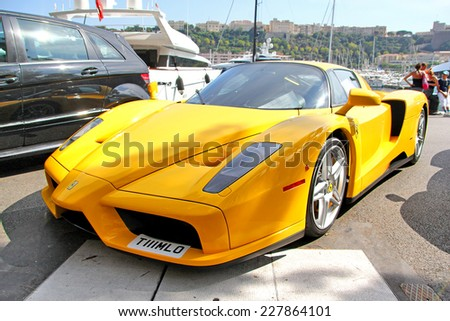 MONTE CARLO, MONACO - AUGUST 2, 2014: Yellow supercar Enzo Ferrari at the city street. - stock photo