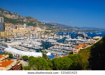 Monte-Carlo, Monaco, France - September 25, 2009: View of the seaport and the city of Monte Carlo in Monaco. Many luxury yachts, ships and cruise liners