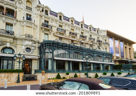 MONTE CARLO, MONACO - JUN 24, 2014: Hotel de Paris near the  Monte Carlo Casino. Monte Carlo Casino  includes a casino, the Grand Theatre de Monte Carlo. It's the main sight of Monte Carlo