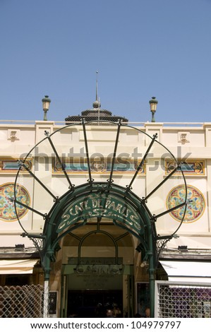 MONTE CARLO, MONACO-MAY 17: The historic canopy and entrance to Cafe de Paris outside the famous Monte Carlo Casino in Monaco draws tourists from around the world on May 17, 2012 in Monte Carlo.