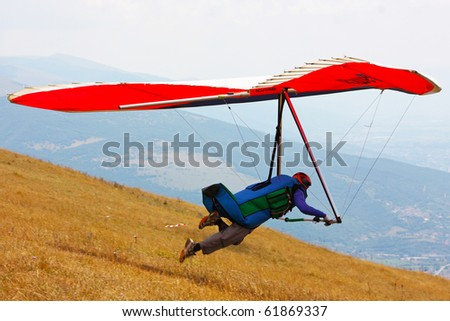 MONTE CUCCO, ITALY - AUGUST 12: Competitor of the Dutch Open-2010 hang gliding competitions taking part on the Monte Cucco mountain on August 12, 2010 near Cigillo, Italy.