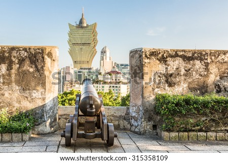 Monte Fort, or Fortaleza do Monte, was built by the Portugese in the 17th century when they controllled the island in the South China Sea. The canon aims at modern casinos nowadays. - stock photo