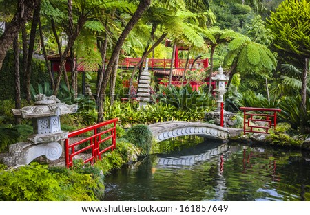 Monte Tropical Gardens with red Japanese style pavilions, Funchal, Madeira island, Portugal