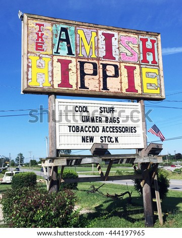 "MONTEAGLE, TN-JUNE 24, 2016:  Sign for the ""Amish Hippie"", an alternative gift shop in the hills of Tennessee."