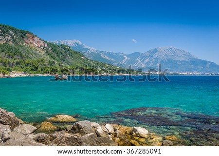 Montenegro coast seascape near Sutomore and Bar towns and calm and sunny summer day. - stock photo