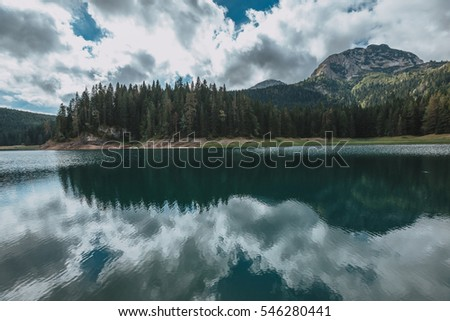 Montenegro, national park Durmitor, mountains and clouds. Black Lake (Crno Jezero) in Durmitor - Montenegro - nature travel background