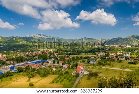 Montenegro rural meadow and village houses view. Montenegro. - stock photo