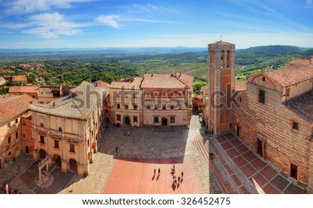 Montepulciano town panorama in Tuscany, Italy. Historic city center. View from Communal Palace on La Cattedrale di Santa Maria Assunta - stock photo
