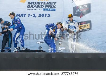 Monterey, CA - May 03, 2015:  The winning drivers celebrate in victory lane after winning the Grand Prix of Monterey at Mazda Raceway Laguna Seca in Monterey, CA. - stock photo