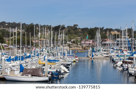 MONTEREY, CA, USA - MAY 22: Historic Monterey Harbor and Marina is in the Monterey Bay National Marine Sanctuary, the largest Marine Sanctuary in the world. May 22, 2013, Monterey, California. - stock photo