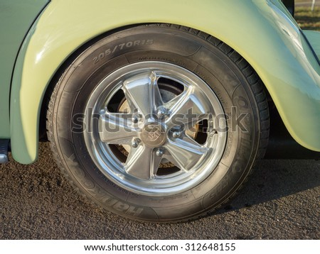 MONTEREY CAR WEEK August 16, 2015: Close up of Green 1st Generation Volkswagen Beetle of the 50s with single Porsche wheel.  - stock photo