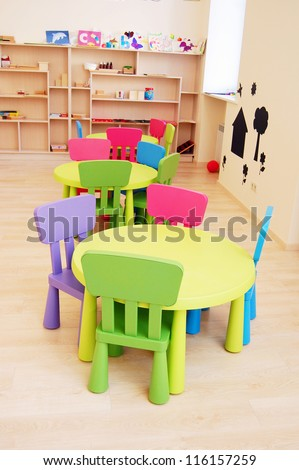 Montessori Kindergarten Preschool Classroom with table and chairs - stock photo